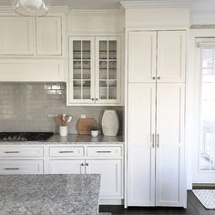 inset cabinet doors. benjamin moore white shaker style cabinets. white kitchen with grey backsplash. #whitekitchen Shaker Style Kitchen Cabinets, White Shaker Cabinets, Shaker Style Kitchens, Refacing Kitchen Cabinets, Kitchen Cabinet Styles, Grey Kitchens, Cabinet Refacing, Cabinet Ideas, Cabinet Makeover