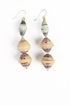 THE DETAILS Handcrafted from paper beads that are rolled and strung by mentally and physically disabled individuals at a nonprofit community center in Rwanda, each pair of earrings is truly one-of-a-k