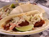 Carnitas Tacos with Spicy Slaw by Sandra Lee.  So incredibly easy and inexpensive!