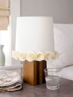 Add affordable accents to each room, like these whimsical DIY paper rosettes glued to a plain white lampshade. This is it for my crazy table/lamp, said with Love. White Lamp Shade, Lamp Shades, Cheap Home Accents, Diy Papier, Paper Roses, Paper Decorations, Geometric Lamp, Geometric Lines, Paper Flowers
