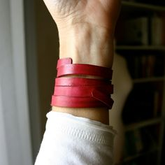 """Add a splash of color with this leather wrap bracelet. This leather bracelet is a strip of leather that has been dyed and wet formed to wrap around your wrist several times.  Light and comfortable to wear. It has been waxed, but is not waterproof.  Shown in Cranberry. This width varies 1/4"""" - 3/8"""" It's approximately 31"""" long."""