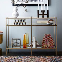 Top brass. Inspired by mid-century design, the Terrace Console's glass shelves appear to hover above a mirrored glass base, bringing a floaty elegance to living rooms.