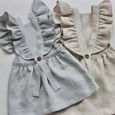 Pure linen girls dress from 0-3months up to 5-6years. Made from a natural linen. The detail to the shoulder frills is pristine and it comes complete with adjustable button fastening. Sizing is true to size if not a little roomy Machine washable at 30 degrees Available in dove, mocha and