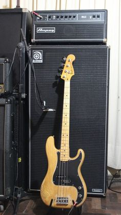 Maple Fender Precision Bass. Behind: Ampeg bass stack
