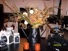 Spray painted an old watering can and added fall flowers