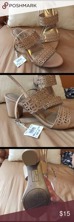 Sandals with heels BRAND new! Never worn, with tag still attached. Really comfortable I just bought the wrong size. Shoes Sandals