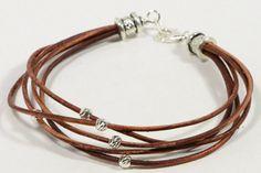 Multi brin bracelet fait de cordon de cuir naturel et diamant taillé Gourmette de 5 mm en argent sur cordons de cuir naturel finition perles tube