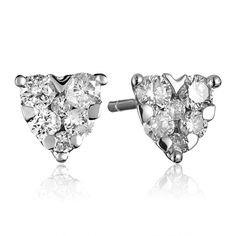 These heart shaped diamond clusters are crafted of 18k white gold. They feature 0.39 Carat T.W. round diamonds.