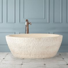 The chiseled exterior of this stone tub brings unequaled appeal to your bath. Completed by a polished rim and interior, this bathtub displays the unique characteristics inherent in each stone. Pair with a freestanding tub filler or wall-mounted faucet to Blue Paint Colors, Exterior Paint Colors, Japanese Soaker Tub, Stone Tub, Art Deco Bathroom, Bathroom Inspo, Pedestal Tub, Freestanding Tub Filler, Bathroom Renos