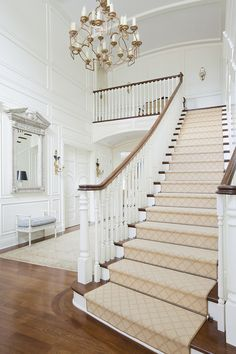 stairs | entry | thank goodness for brushed (or a quieter) type finishes of brass! For those who love silvers and chrome, the dull brass finish is livable and handsome in this entry.