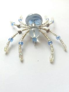 Check out this item in my Etsy shop https://www.etsy.com/listing/599888871/decorative-blue-silver-spider-made-from