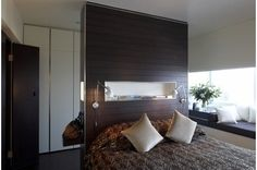 "When you have a room in which the bed needs to ""float,"" what do you do? Consider a room-divider headboard. This ingenious solution does doub..."