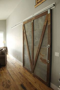 Sliding barn door home decor reclaimed wood corrugated steel Grain Designs Fargo