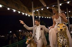 The first ride on a carousel as husband and wife at this Nashville Zoo Wedding  Nashville Zoo Wedding. Nashville Wedding Photographer. Zoo Wedding. Fun Wedding Ideas. Bride and Groom.