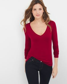 "A must-have in every woman's wardrobe, our long-sleeve V-neck layering tee is a casual essential with endless versatility. Dress it up with dark wash jeans and our coveted Olivia pumps for a casual Friday look.  Long-sleeve V-neck layering tee in luscious red Approx. 26"" from shoulder; hits at hip Rayon/spandex. Machine wash cold. Imported"