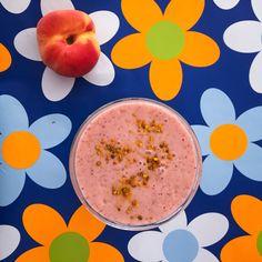 Peach Raspberry Smoothie. Saturn peaches, fresh raspberries, homemade almond milk, raw honey, vanilla, few slices of frozen banana or yogurt,  splash of fresh orange juice, and bee pollen. @chakrashakes on Instagram