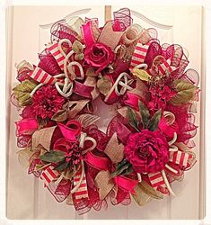 This inspired Vintage Rose Burgundy and Red Deco Mesh Wreath will delight all who see it.  The rich color combination will brighten any room of