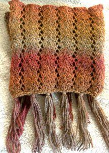 There's nothing better than a lacy knit scarf pattern that offers color and warmth. Get the free knitting pattern for the December Sunrise Scarf here!