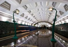This looks like the DC Metro system - except for the fabulous light fixtures here.    Slavyansky Bulvar Metro Station, Moscow, Russia