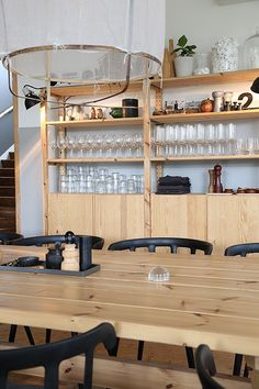 Ikea PS 2012 chairs and Ivar shelves in a Swedish restaurant.