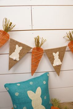 This adorable burlap Easter bunny pennant & carrot banner is made with painted bunnies and carrots. The bunnies have the cutest little fluffy tail. The carrots have green raffia at the top. *****All orders placed by March 15 will arrive in time for Easter! *****  Total size of the each bunny pennant is approx 6.5 wide and each carrot is 3 wide at the top. They are sewn to twine for hanging. There is approx 3 ft of twine on each end! This banner is sealed and the edges are finished and wil...
