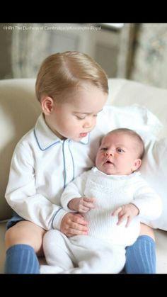 How cute is Prince George with his little sister Princess Charlotte