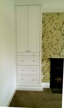 Grand fitted wardrobe with double height skirting and period moulding