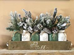 This is absolutely a stunning piece to add to any space in your home!!! Everything is included in this winter wonderland centerpiece Greet your guest this holiday season with a wintery frolic of the holiday season Package includes everything in the picture (1) planter box with hand painted stencil. NO vinyl lettering or paint marker used (2) handles (6) homemade chalk painted mason jars. Distressed and sealed for protection (6) floral Dimensions Include: 26.25X5.5X3.5