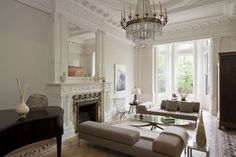 : Ordinary Residence Family Room Interior With Light Brown Sofa Bench And Glass Coffee Table With Crystal Chandelier