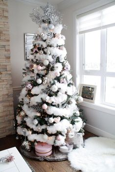 white christmas White Feathered Blush Pink faux flocked Christmas Tree - Glam Christmas Home Tour on Chandeliers and Champagne White Christmas Tree Decorations, White Christmas Trees, Traditional Christmas Tree, Beautiful Christmas, Christmas Home, Christmas Mantles, Champagne Christmas Tree, Vintage Christmas, Christmas Villages