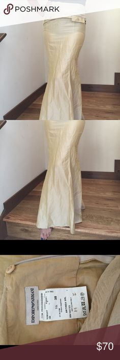 "BEAUTIFUL Authentic Emporio Armani Long Skirt 💋👠 beautiful Gold Emporio Armani Long Skirt. Size 38 and fits like a size 2-4. Perfect snug fit at the waist with back zipper and button, and flared at the bottom. This skirt is simply luscious. Waist measures 14"" and length is 42"". ❤️💋 Emporio Armani Skirts"