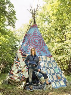 Tipi in the back yard. This one is made from old quilts.