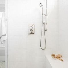 Shower with White Subway Tiles and White Grout