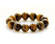 Tiger Eye Beads Buddhist Bracelet for Meditation Ovalbuy. $7.99. Material: Tiger Eye. Beads Size: about 16mm. elastic cord. Free Jewelry Pouch
