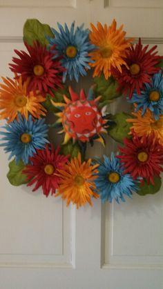 Gerbera daisy wreath in hot Summer colors.