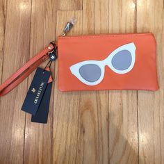 Genuine leather wristlet. *BRAND NEW* ORA DELPHINE genuine leather wristlet. Dust bag included. Sunglasses detail on front in white and grey. Ora Delphine Bags Clutches & Wristlets