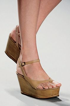 I love these type of wedges.  Your feet doesn't arch to unnatural positions, and you still get the height.  They're also very versatile with any outfit you have.  And, I love the tan color.