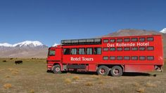 Check out the Rotel! Rotel is the acronym for a rolling hotel, a fleet of coaches that operate throughout Africa, Europe and Asia that incorporate a tourbus upfront and sleeping quarters in the rear.