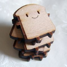 Cute wooden Bread Slice brooches with laser engraving. These happy Bread Slice brooches have been laser cut from Beech plywood to Marceline's design with laser-engraved details. A brooch pin is attached securely on the back so he can come everywhere with you, on your coat or bag!