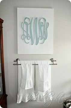 Monogrammed DIY canvas  Love this idea with maybe a different font for monogram and use colors to match room.