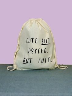 """Lustiger Turnbeutel in Weiß mit schwarzer Aufschrift """"psycho but cute""""/ funny backpack in white with black lettering made by purple via DaWanda.com"""