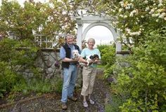 Love the archway into the garden in this pic. Climbing plants help mix it into the stone work.