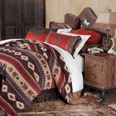 Classic western colors and bold southwestern patterns give this thick cotton and faux leather bedding character and spirit. Bedding sets include comforter that reverses to a soft faux suede, fringed and studded faux leather bed skirt, toss pillow, and Western Bedding Sets, Rustic Bedding, Linen Bedding, Bed Linens, Country Bedding, Rustic Bedrooms, Cowhide Decor, Cowhide Furniture, Antique Furniture