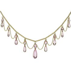 Antique Pink Topaz Necklace, England, Circa 1890. Pink topaz festoon necklace, set in 15k gold and consisting of 9 drops.