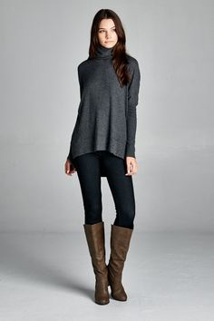 Drape yourself in luxury in our soft and o so comfy Iceland Luxe Knit Turtleneck. It features a loose fit, long dolman sleeves, turtleneck, and hi-low hem. 62