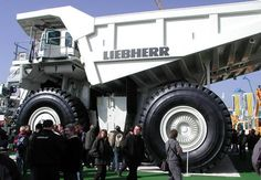 Liebherr T 282B - World's Biggest Truck This monster machine Liebherr T 282B is a large earth-hauling dump truck designed in 2004 by a German manufacturer and became the largest earth-hauling truck in the world. It can carry about 360 tonnes (400 tons) at 64 km/h.He adds that this is an unconventional truck. It has a 2723-kilowatt diesel engine which powers two electric motors