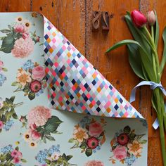 Surprise those on your holiday gift-giving list with this double-sided floral bouquet neon wrapping paper.