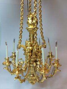 Aurelie Masselin - Les Miniatures de l'Once d'Art - copy of a chandelier at Versailles. Original by Pierre Gouthière. This is gilded over bronze. price € 990.00 (approximately $1260)