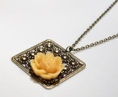 Buttery Yellow Rose on a Brass Daisy Square Necklace