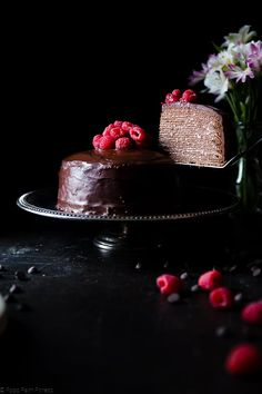 These chocolate vegan crepe cake is layered with raspberries and creamy coconut! It's an impressive healthier, gluten and dairy free dessert!